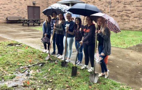 GATE students at the ground breaking for the rain garden by the greenhouse.
