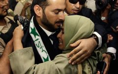 Muntadher al-Zaidi with his sister after being freed from prison in 2009.