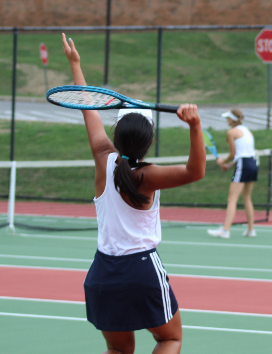 The girls tennis team is back on the court after a 14-day quarantine.