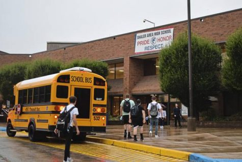Students make their way to the main entrance at Shaler Area High School.