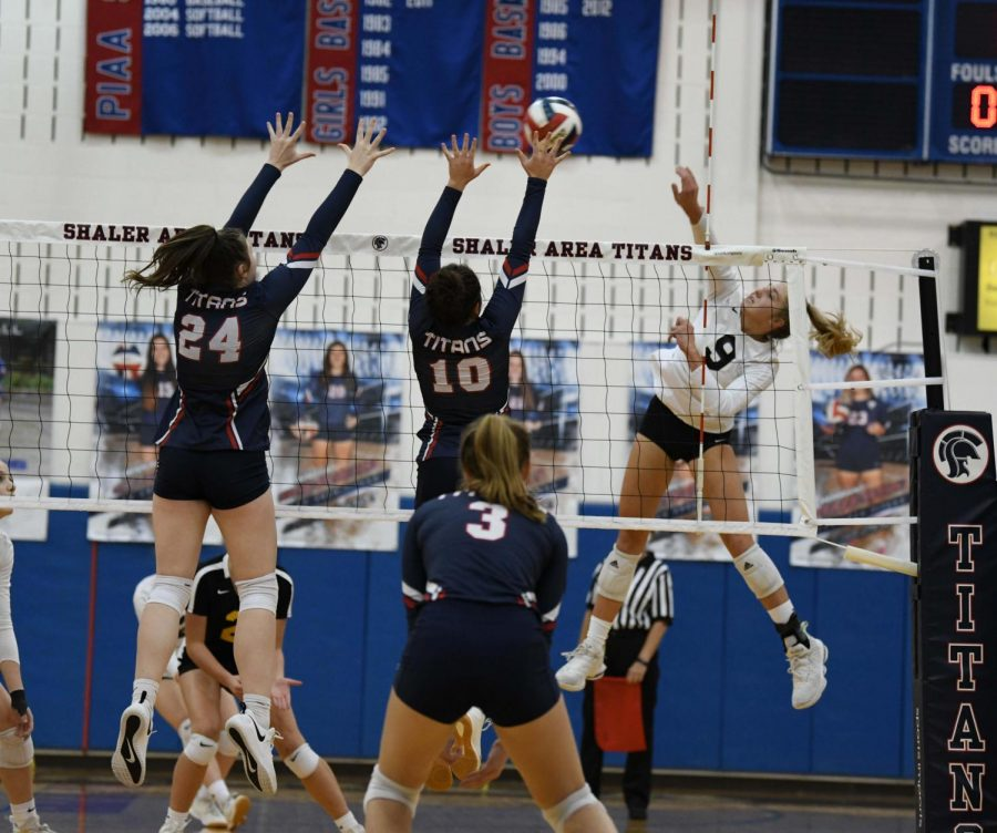 Mackenzie Barr and Tia Bozzo go for a block vs North Allegheny during Oct 20 match