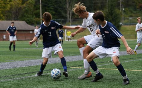 The Titans battle for the ball in game vs. Highlands