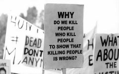 A protester carries a sign from an anti-death penalty rally