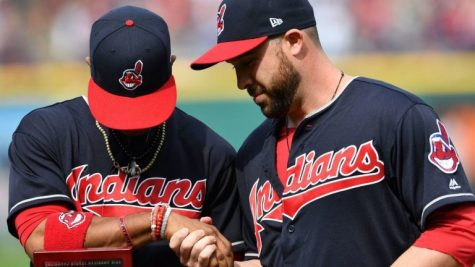 "Two Cleveland Indians players wearing the now retired ""Chief Wahoo"" logo on their uniforms"