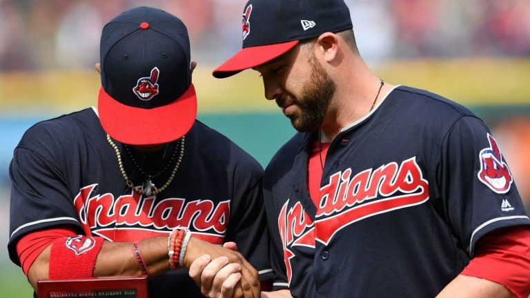 Two+Cleveland+Indians+players+wearing+the+now+retired+%22Chief+Wahoo%22+logo+on+their+uniforms