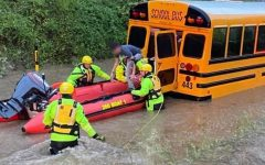 Shaler Area students are rescued from their school bus which stalled in a flash flood