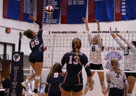 Senior Mia Schubert attempts a kill vs North Allegheny during the Titans 3-0 victory earlier this season.
